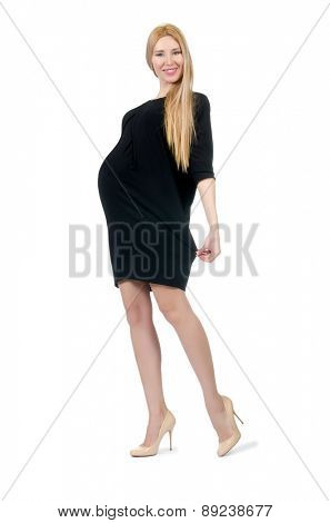 Pretty pregnant woman in mini black dress isolated on white