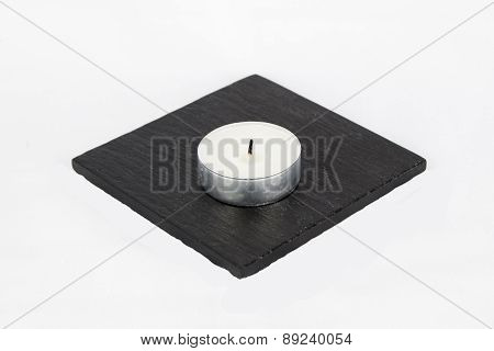 T Light Candle On Stone Coaster, Isolated, White Background.