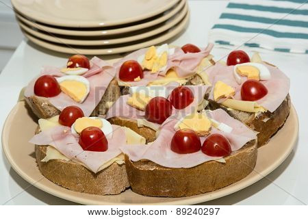 Sandwiches With Egg, Cheese, Ham And Cherry Tomatoes