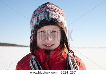 Young Girl In Knitted Cap