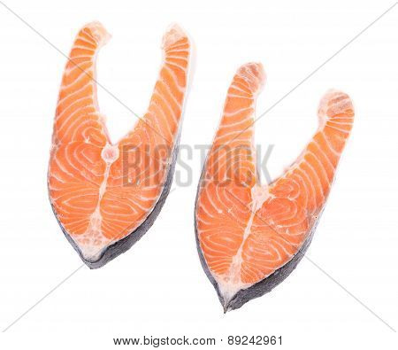 Two fresh salmon steaks.