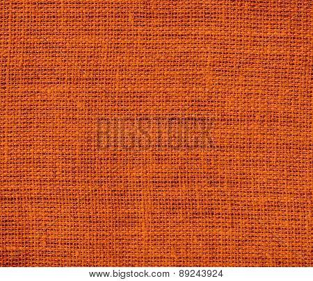 Burnt orange color burlap texture background