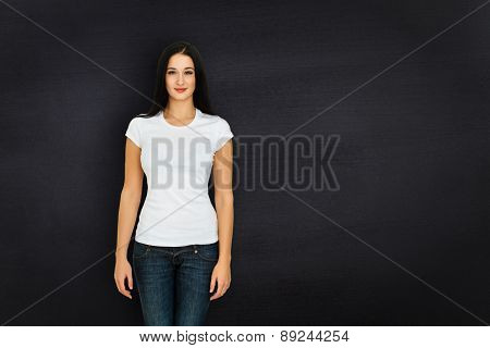 Woman against black background