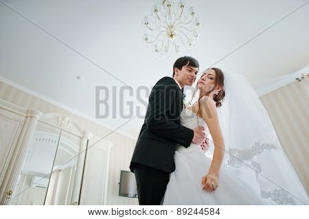 Young Beautiful Wedding Couple At The Hotel Room