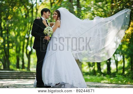 Young Beautiful Wedding Couple With Big Bridal Veil