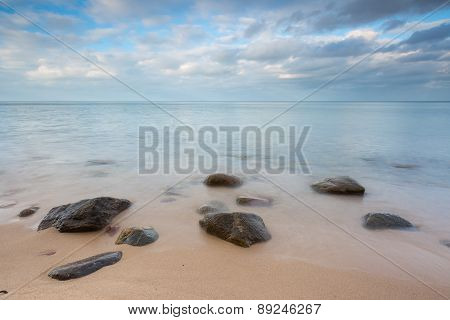 Beautiful Long Exposure Landscape Of Rocky Sea Shore.