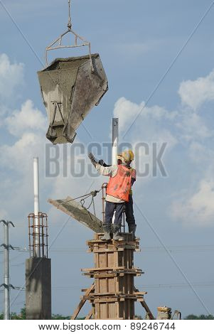Group of construction workers casting column