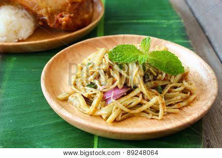 Spicy Bamboo shoot salad on wooden plate