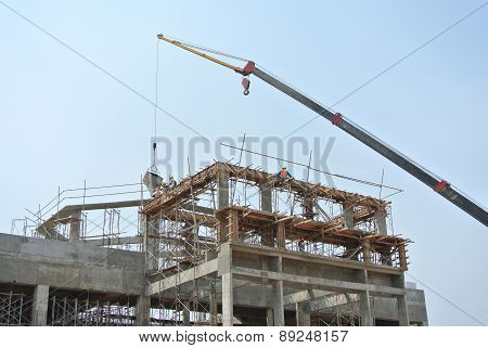 Mobile crane used to lifting heavy material at construction site