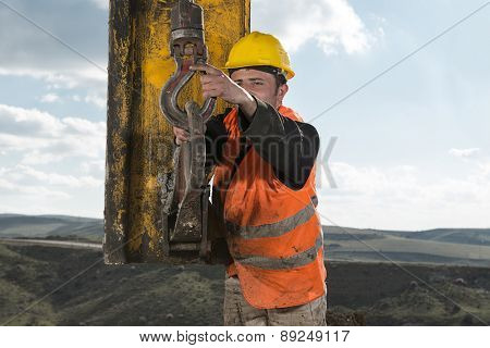 Manual worker working at construction site with space for your text.