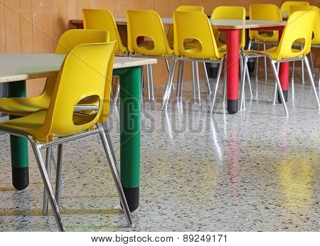 Yellow Chairs And Tables In The Kindergarten