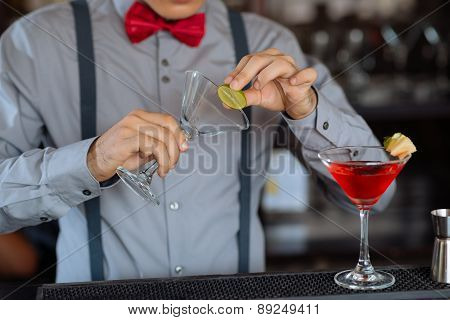 Garnishing cocktail glass