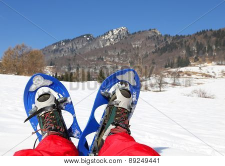 Mountaineer's Legs With Snowshoes For Excursions On The Snow