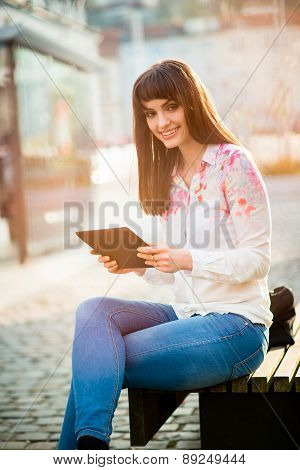Mobilty - woman with tablet on street
