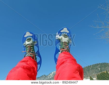Mountaineer's Legs With Snowshoes For Excursions In The Mountains
