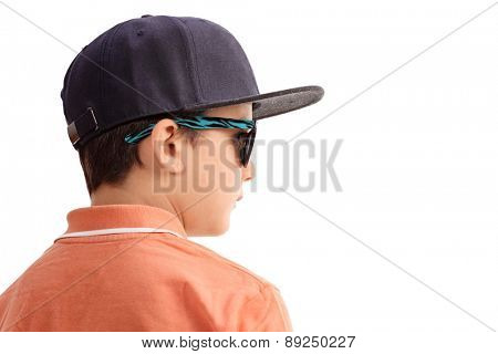 Cool little boy with a cap and sunglasses looking in the distance isolated on white background