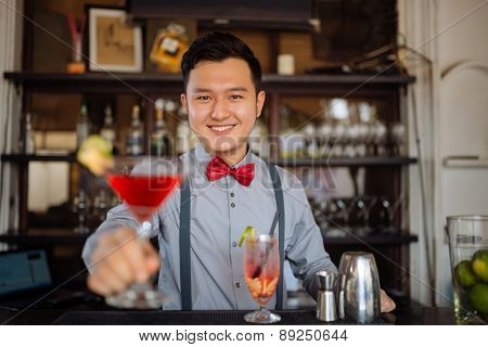 Offering a cocktail