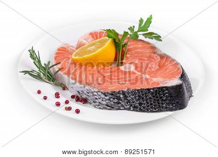 Raw salmon steak with lemon.