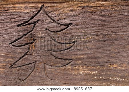 Carved fir tree in weathered wood