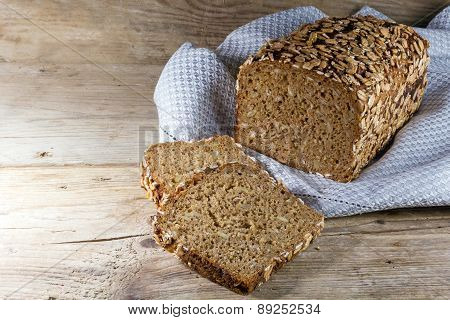 Bread Loaf And Slices On Rustic Wood, Copy Space