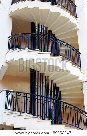 Spiral Staircase On The Outside Facade Of The House