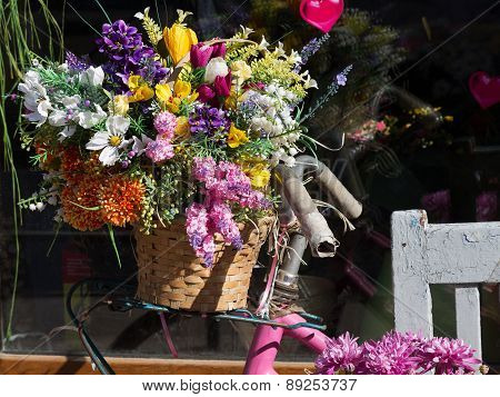 Bright Spring Flowers In A Wooden Box, Iron Bucket In The Background Bike