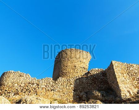 The Crumbling Ruins Of The Old Fort On The Top Of Crimean Mountains In The Bright Sunlight Contrast