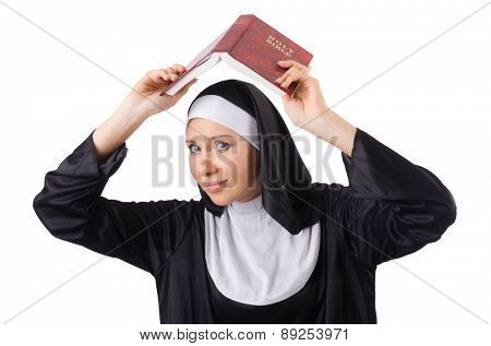 Pretty nun with Bible isolated on white