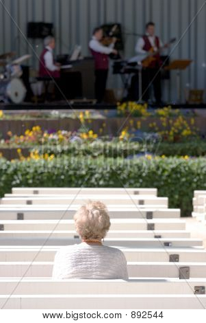 Lone Elderly Woman Watching Jazz