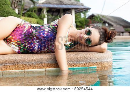 Fashion Girl In Beautiful Bikini Lying Near Swimming Pool