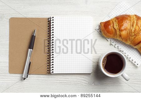 Notepad, Pen, Coffee And Croissant