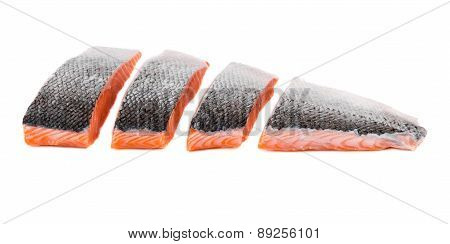 Fresh uncooked red fish fillet slices.