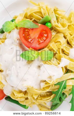 Italian pasta with basil and peas.