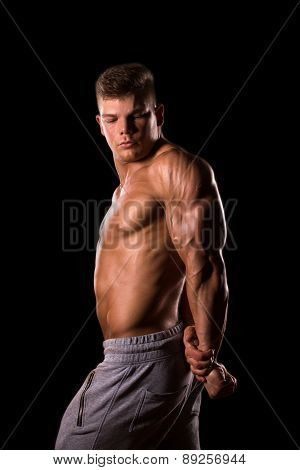 muscular male bodybuilder showing his triceps