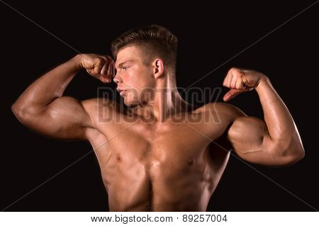 muscle man bodybuilder showing his biceps