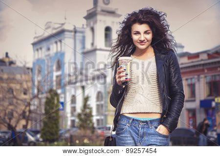 Brunette Beautiful Stylish Caucasian Woman In Casual Outfit On A Walk On European City Street Drinki