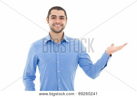 Handsome Arabic Business Man In Blue Shirt Pointing At Something Isolated On White
