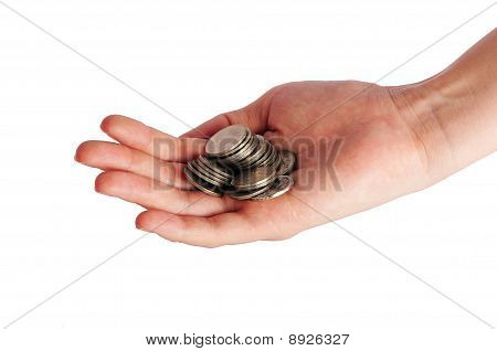 Coins piled up in woman's hand isolated on white