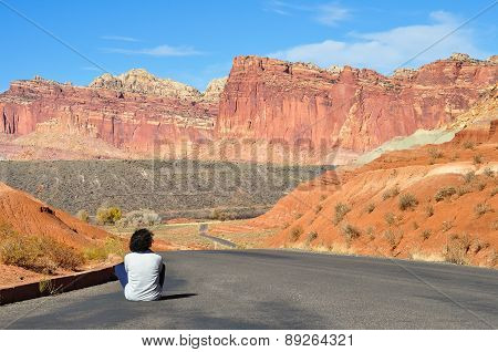 Young Girl Sitting On The Road