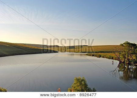 Morning landscape: the sky and a reservoir