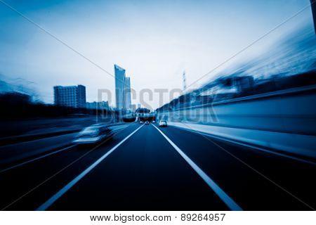traffic at shanghai china. blue toned image.