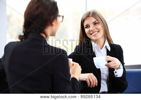 Office Workers On Coffee Break, Woman Enjoying Chatting To Colleagues, Smiling