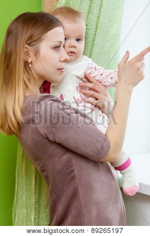 Woman is playing with her baby
