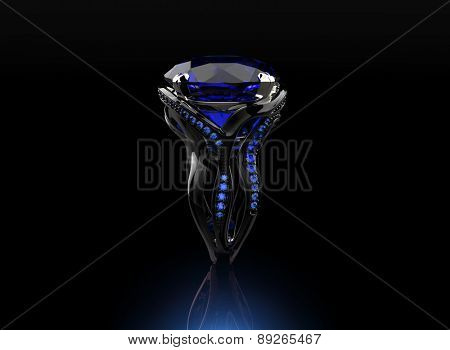 Golden Engagement Ring with sapphire. Jewelry background