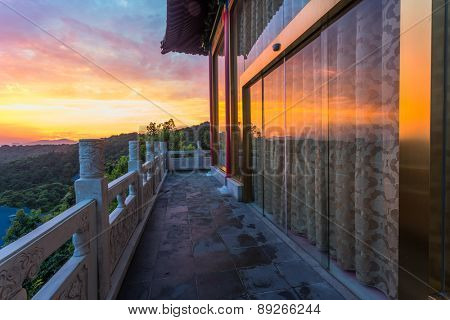 Chinese palace building at sunset .