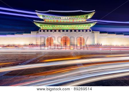 Gwanghwamun gate at Gyeongbokgung Palace in Seoul, South Korea with light trails from moving traffic.