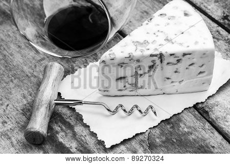 Cheese With Mold, Corkscrew And Wineglass