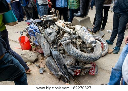 KATHMANDU, NEPAL - APRIL 26, 2015: Two crushed motorbikes next to the collapsed Dharhara tower after the major earthquake on 25 April 2015.