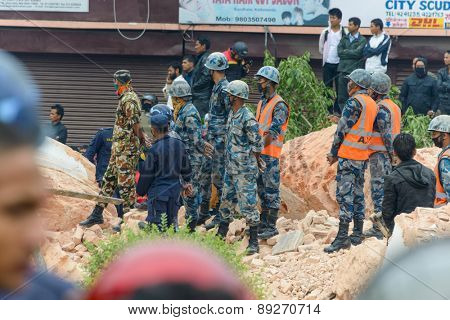 KATHMANDU, NEPAL - APRIL 26, 2015: Nepal Armed Police Force, army and police start rescue efforts at the collapsed Dharhara tower after the major earthquake on 25 April 2015.