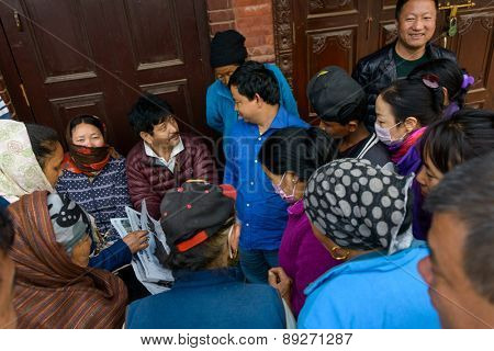 KATHMANDU, NEPAL - APRIL 26, 2015: People try to get news from the papers after the 7.8 earthquake hit Nepal on 25 April 2015.
